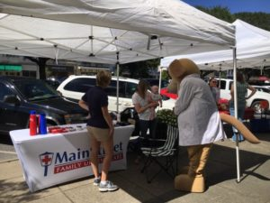 setup for the farmers market by the urgent care, MainStreet
