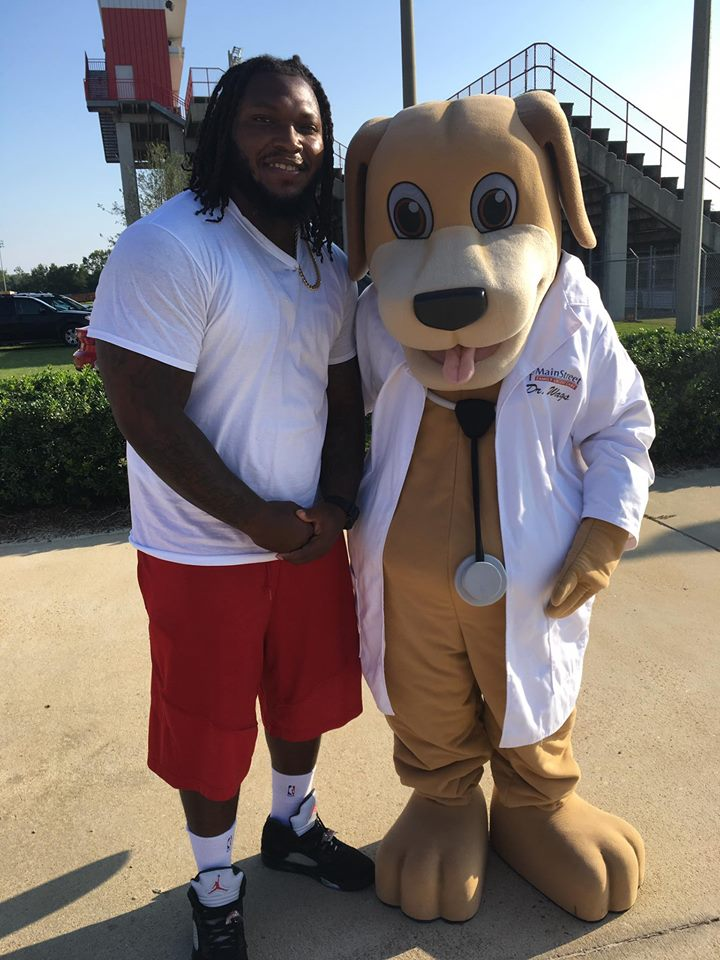 Upshaw Football Camp and Mascot of MainStreet Family Urgent Care