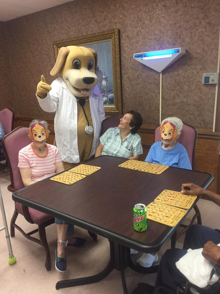 MainStreet Mascot meets elderly friends at Crowne Healthcare of Eufaula