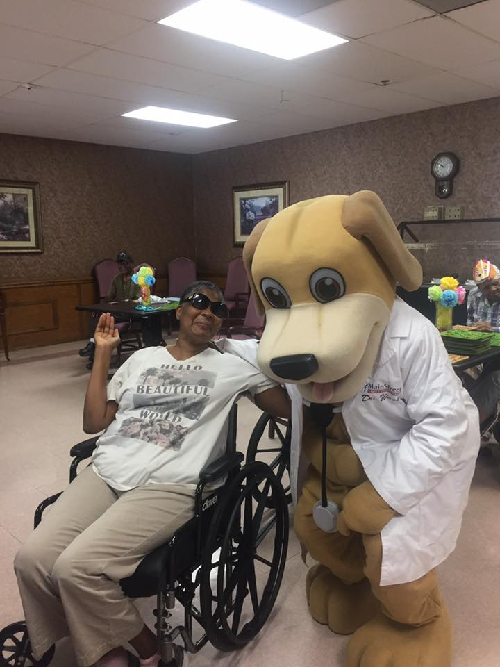 MainStreet Mascot poses with elderly lady