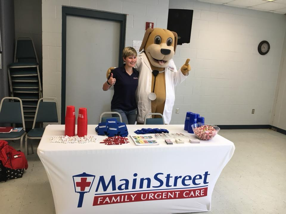 Dr. Wags and Community Educator Katie Strike a Pose at their booth at the City of Eufaula's Health Fair in April at ECC