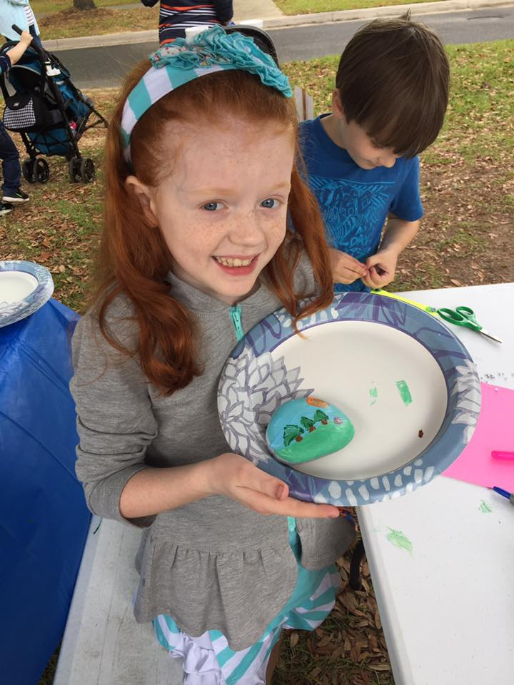 April events Pilgrimage kid paints rock at kids art tent