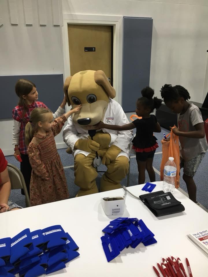Kids at Health Fair at Boys and Girls Club Gym pet MainStreet Mascot Wags in May