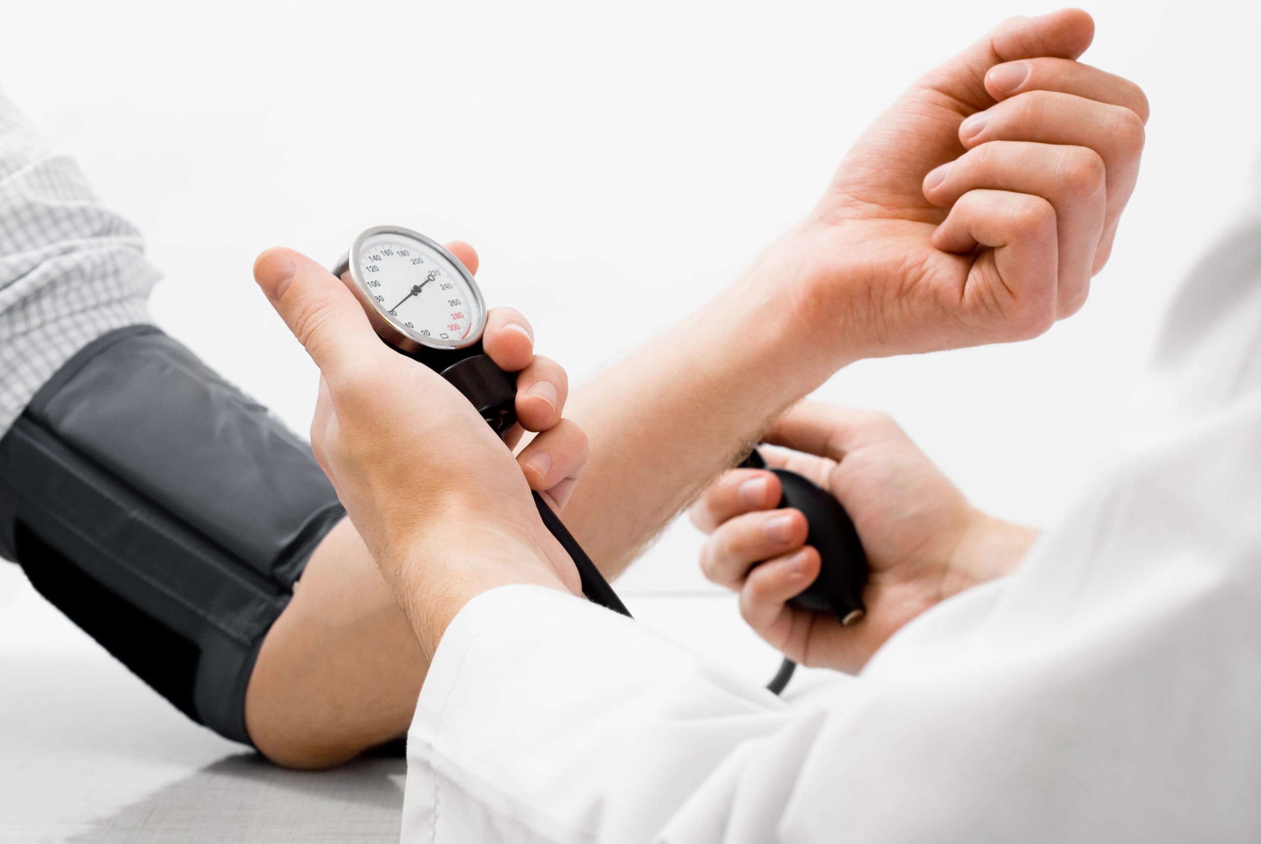 doctor taking blood pressure of insurance and medicaid patient