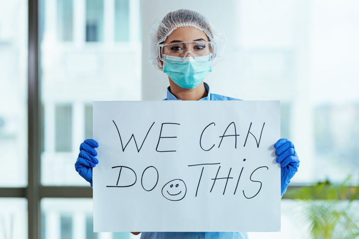 healthcare worker holding sign